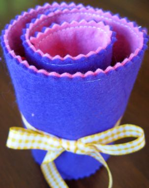 purple felt crayon roll rolled up