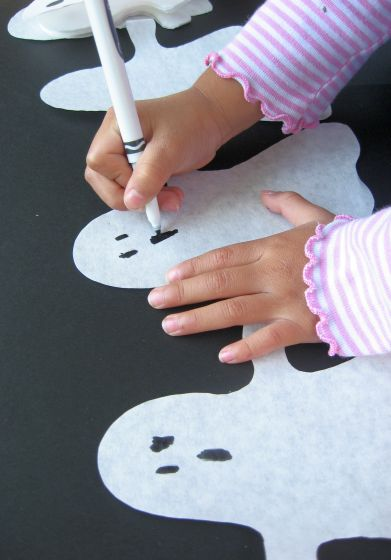 How to Make Paper Ghost Garlands for Halloween (draw faces) by Cindy Hopper for Alphamom.com