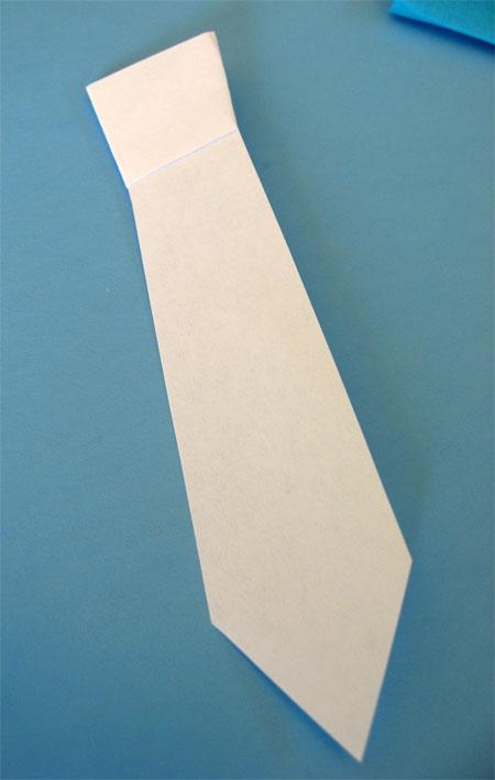 origami tie on white paper