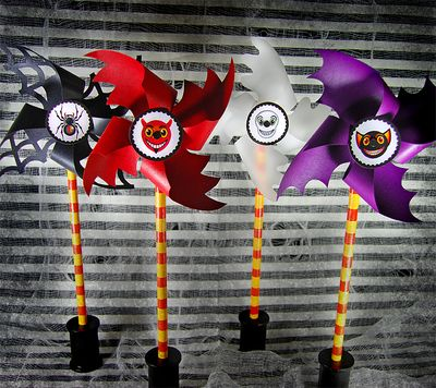 Spooky spinners - black and white with a spider in the middle, red and white with a devil image in the middle, white and black with a skull in the middle, and purple with a bat head in the middle