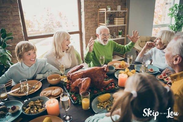 family at Thanksgiving dinner talking