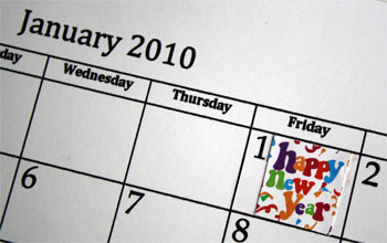 Happy New Year sticker on calendar page
