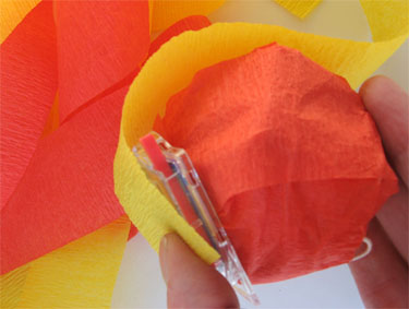 Wrapping treat with orange and yellow crepe paper