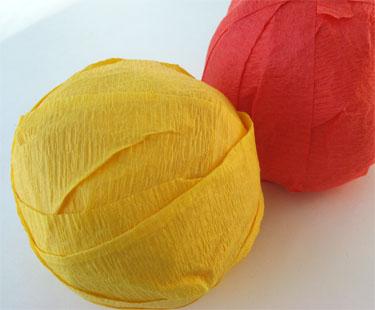 orange and yellow crepe paper balls