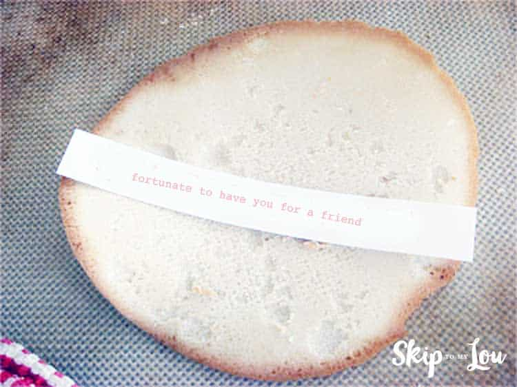 flat fortune cookie with fortune on top before folding