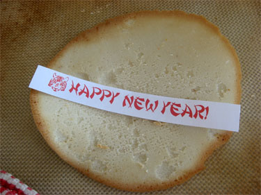 happy new year printable on top of baked fortune cookie