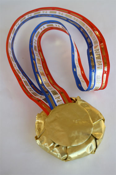 Gold medal cookie with ribbon and foil