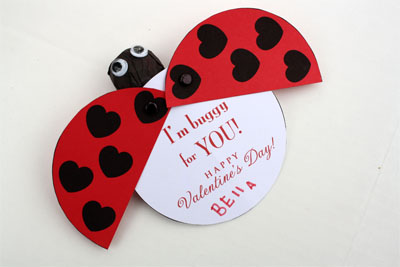 "Lady bug Valentine card with red and black wings that swing out opening to a white card that says, ""I'm buggy for YOU! Happy Valentine's Day!"""