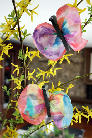 paper butterfly crafts hanging in a tree