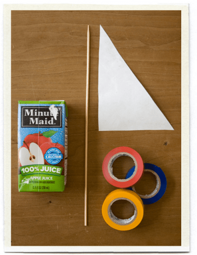 Juice Box Sailboat supplies: juice box, wooden skewer, Tyvex triangle for sail, colored tape