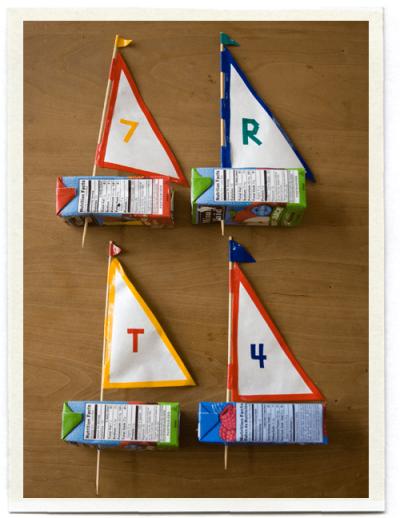 Four Juice Box Sailboats ready to sail