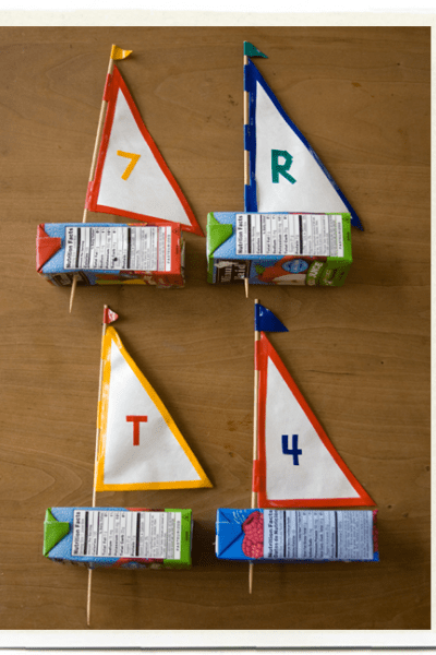 Four Juice Box Sailboats ready to sail