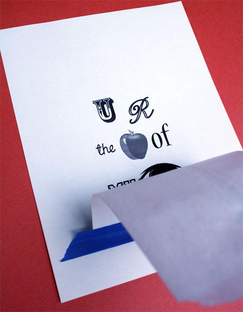 taping a printable image onto a white sandwich bag
