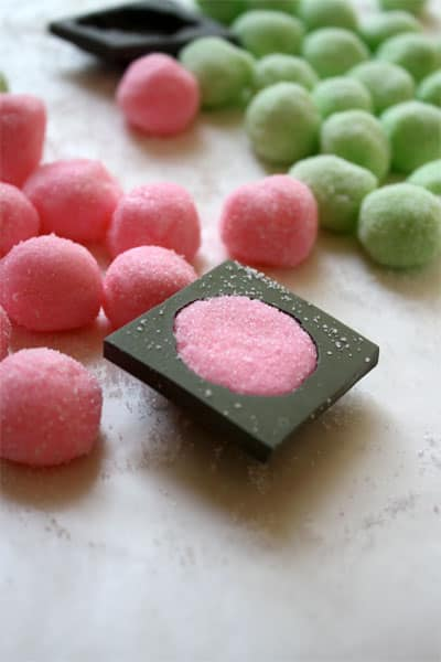 rolled pink and green balls with rubber mint mold