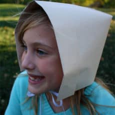 girl wearing pilgrim bonnet