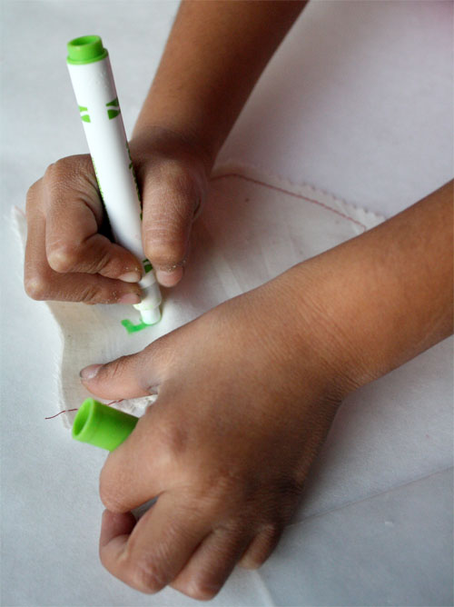 Coloring fabric with markers