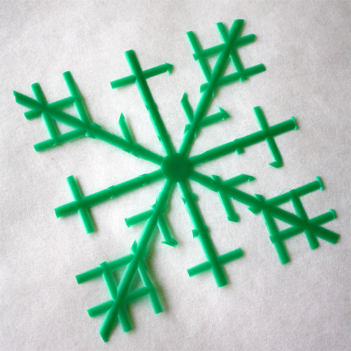 shape of snowflake made from plastic berry basket