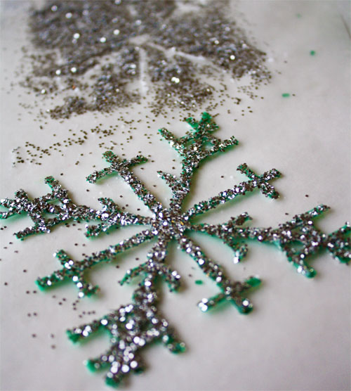 Glitter sprinkled on plastic snowflake