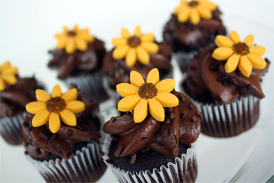 sunflower cupcakes on white plate