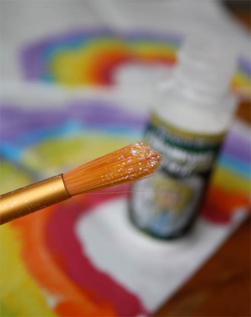 glitter dust on paintbrush