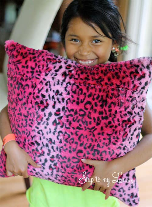 child holding diy pillow