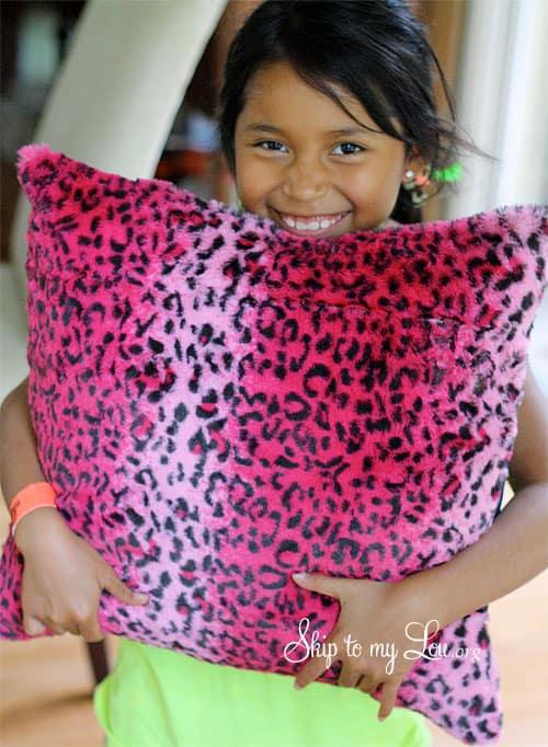 child holding diy pillow