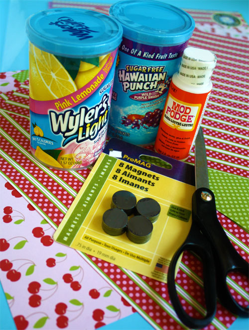 supplies needed for magnetic pencil holder craft (drink mix containers, magnets, mod podge, scissors and scrapbook paper)