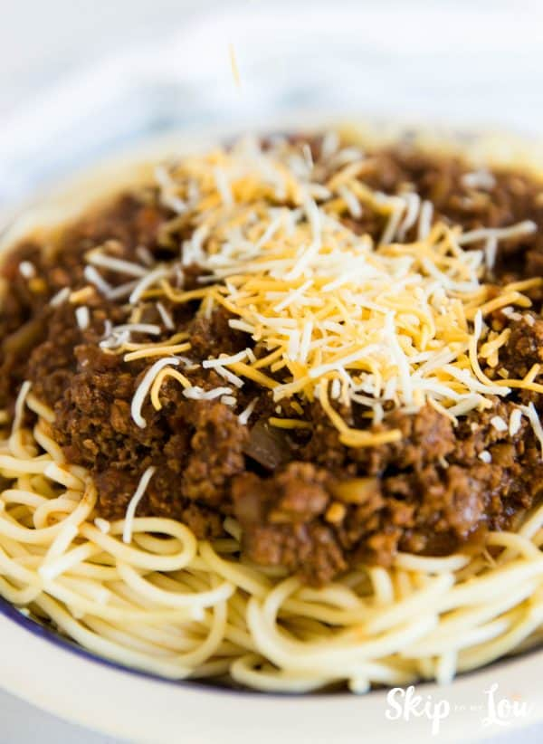 A bowl of Cincinnati Chili topped with cheddar cheese - ready to eat