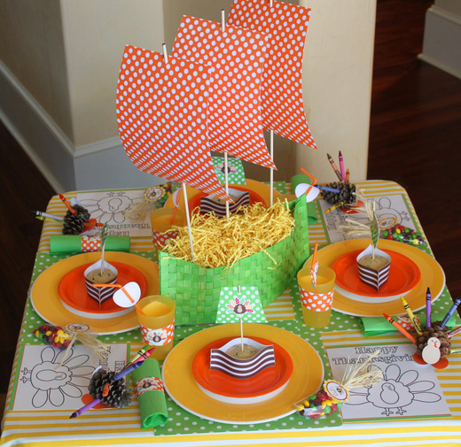 colorful table setting for kids paper mayflower made out of patterned paper each place has yellow paper plates and a small mayflower ship