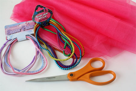Supplies needed for DIY Tutu skirt: tulle, elastic head bands, and scissors