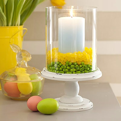 grab and extra bag of jelly beans and fill a hurricane what simple and festive table decoration from all you