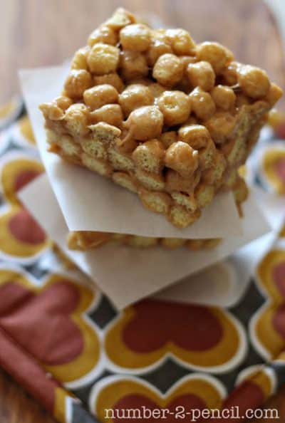 peanut butter treats with wax paper between them