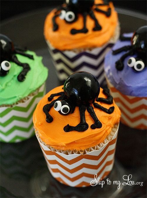 an idea for a fun Halloween cupcake . These gum ball spider cupcakes ...