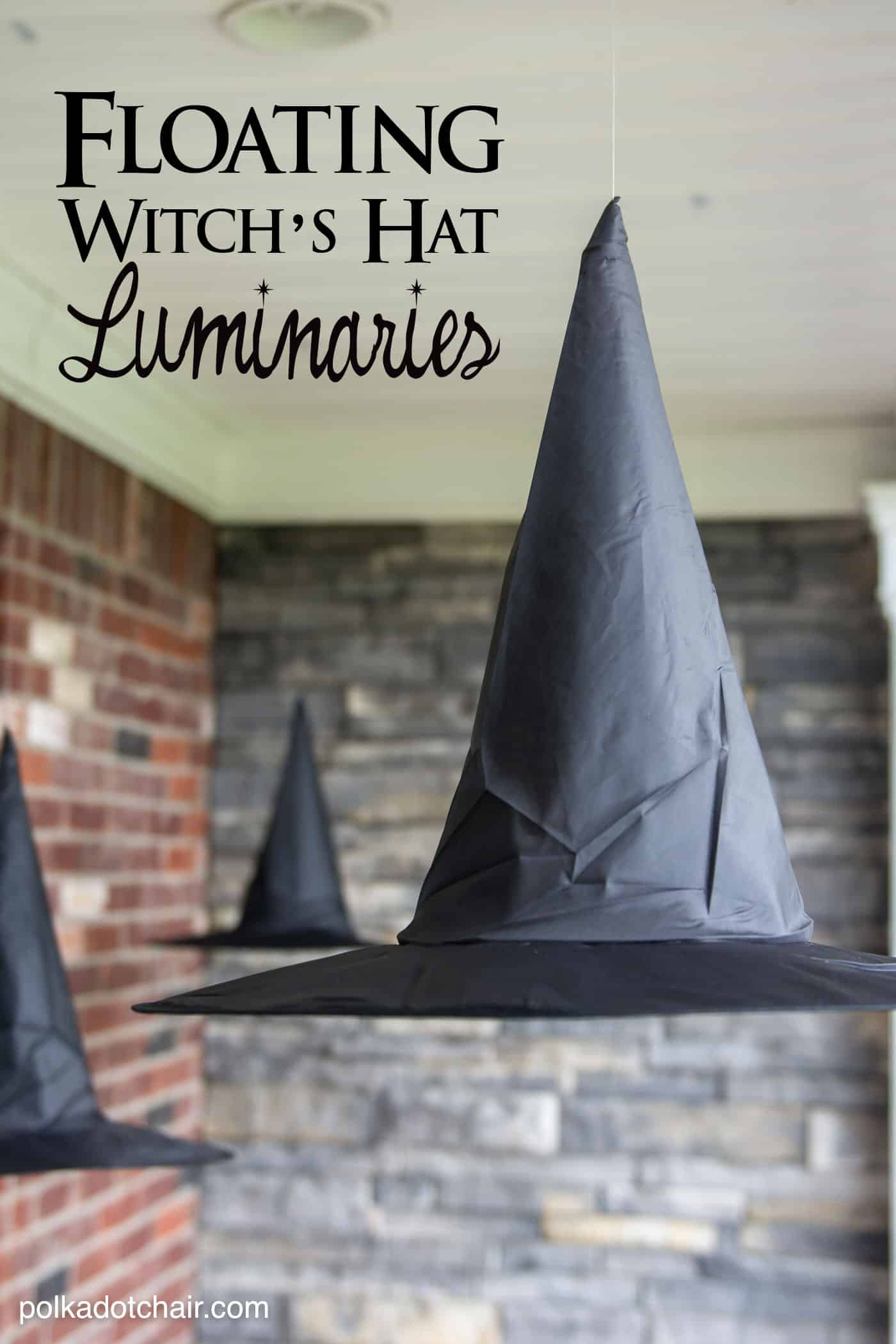 Halloween decorations - Floating witch's hat luminaries - three witches hats on hanging from a porch ceiling