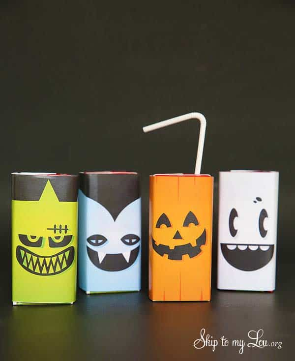 Printable juice box covers with Frankenstein's (green and black), Dracula's (blue and black), Jack-O-Lantern (orange and black), and ghost (white and black) faces on them. 9