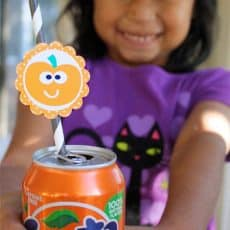 halloween party circle on drink can child holding