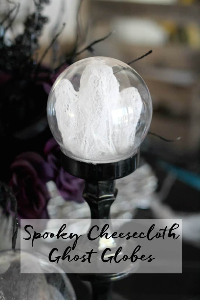 DIY Halloween decoration spooky cheesecloth ghost globe on a black pedestal