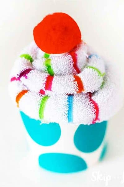 sock cupcake with red pom pom cherry