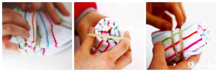 hands rolling up sock and fastening with a rubber band