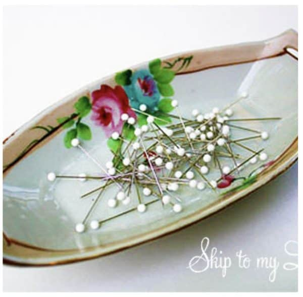 magnetic pin holder mother's day gift idea - porcelian dish decorated with flower print with straight pins on it