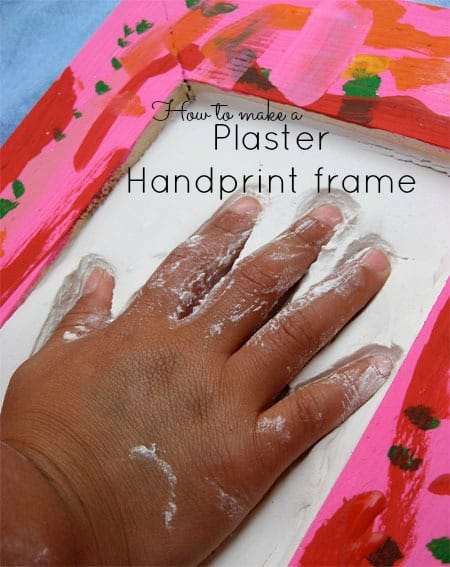 beautiful mother's day gift idea pink decorated frame with a hand pressing into plaster inside the frame - plaster handprint frame