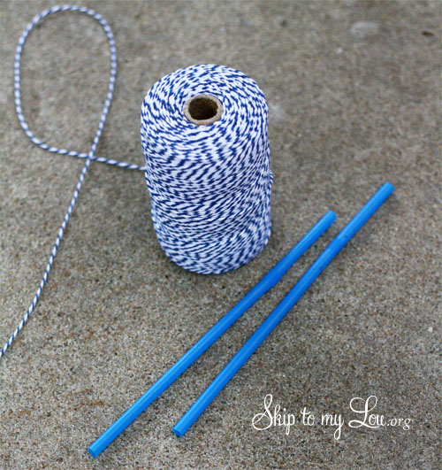 blue and white cotton string and two straight blue straws for the wand