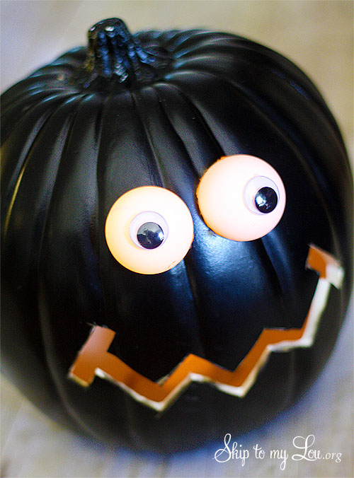 pumpkin with lighted DIY eyes