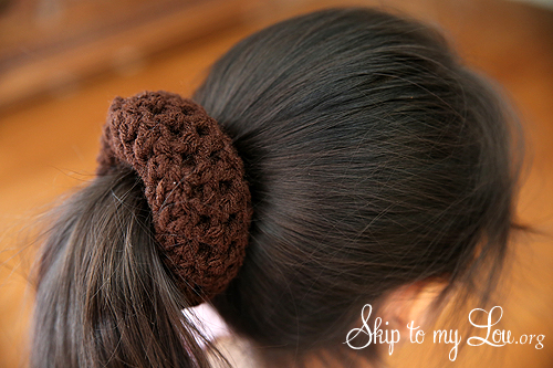 Let hair cover around the crochet bun shaper so it is completely ...