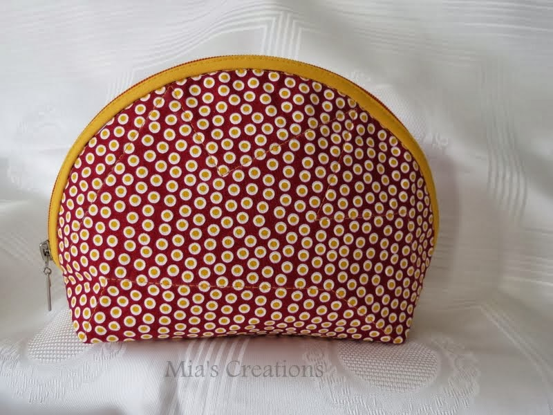 red dot make up bag