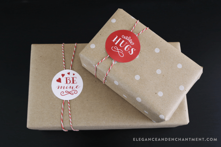 printable circle valentine stickers on boxes wrapped with kraft paper