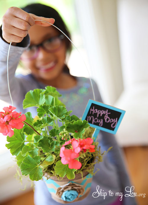 Child holding May Day Basket