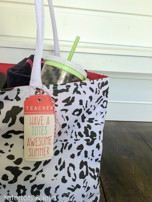 "teacher appreciation summer tote with free printable attached to should strap that says, ""teacher - have a totes awesome summer"""