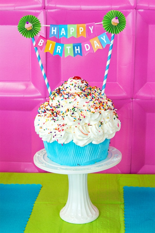cupcake birthday cake with happy birthday bunting on top