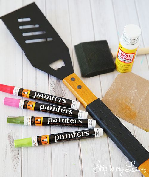 spatula paint pens sandpaper mod podge foam brush